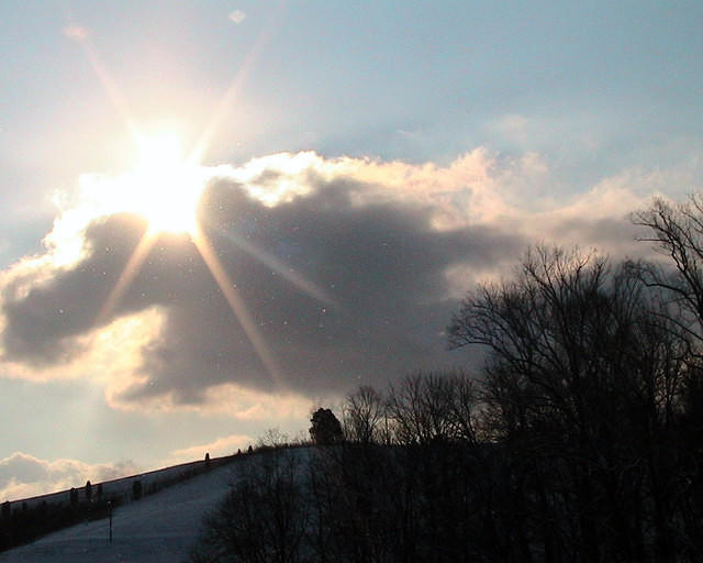 Sunburst Over Snowy Hill