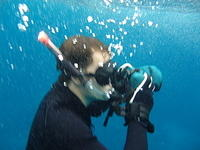 underwater snorkler taking a picture