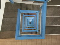 Stairwell with blue railing