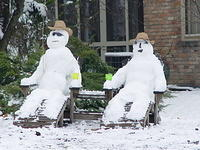 Snowmen in lawn chairs