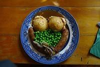 Bangers & Mash on old china plate on wooden table