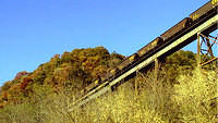 Empty Coal Cars Going Over Trestle