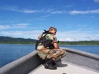 soldier in front of boat