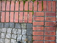 Paving stone and red bricks corner